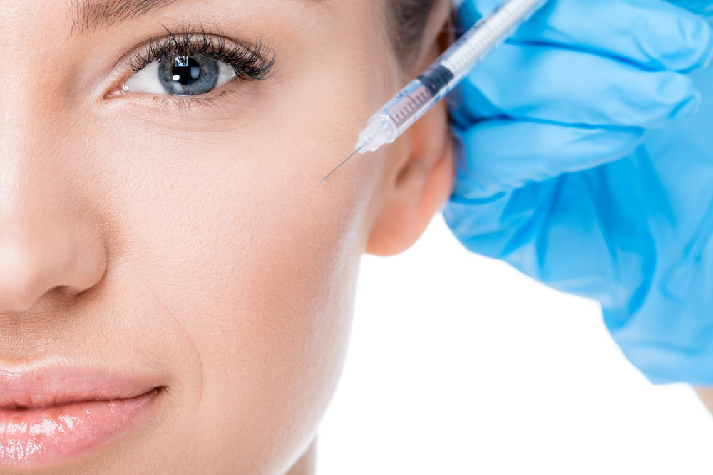 woman receiving filler injection in london