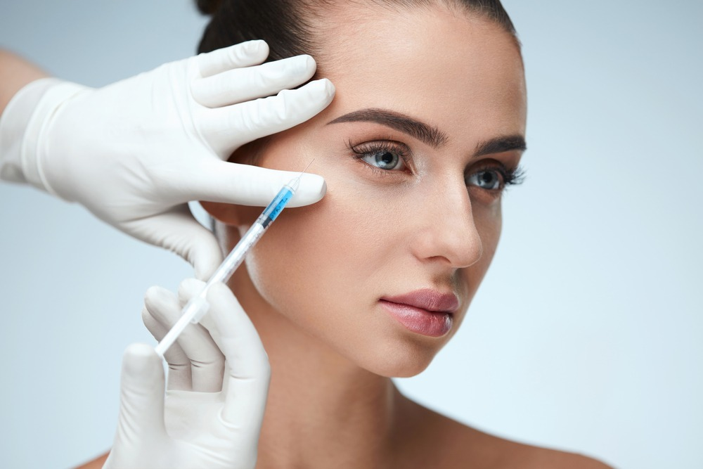 A beautiful woman is having filler injections in the skin